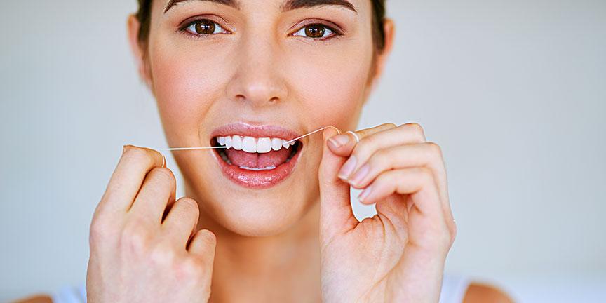 Flossing daily improves dental hygiene