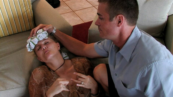 Sean Cobb tends to his wife Mandy Hughes as she suffers a seizure in Under Our Skin.