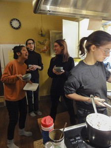 Paige preparing the meal with other students