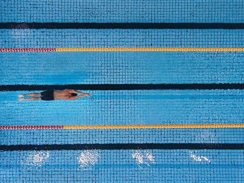 Man Swimming in a Commercial Lap Swimming Pool in Arizona