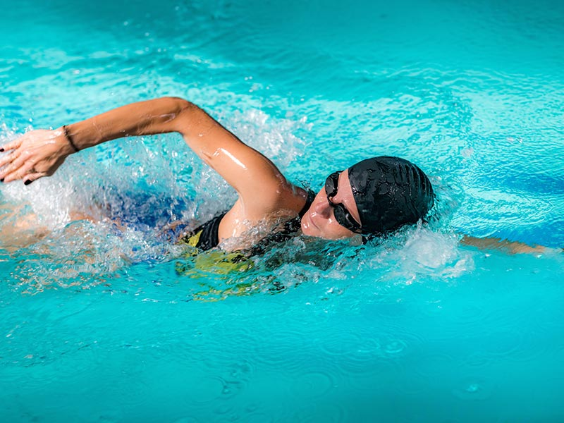 Woman Swimming in a Lap Pool