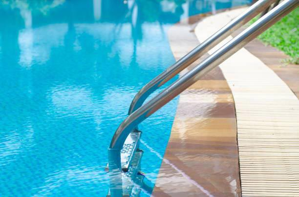 Close up of swimming pool edge showing the infinity style