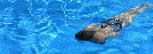 Woman swimming in a lap Swimming Poo