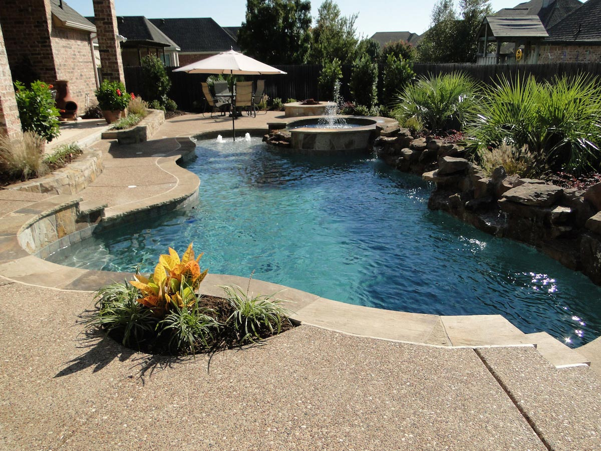 Custom free style swimming pool with rock and water features