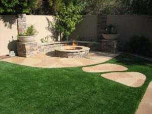 Stone fire pit with flagstone walking steps