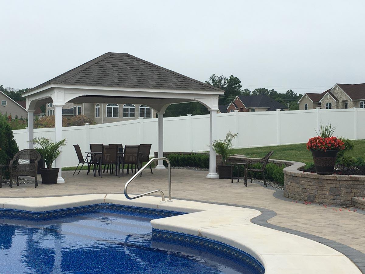 White vinyl pavilion with a custom built swimming pool in arizona