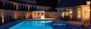 Custom Swimming Pool with a white vinyl gazebo