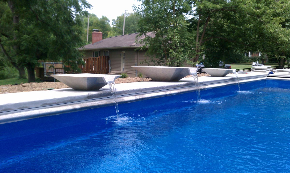 Custom swimming pool services for water feature bowl in swimming pool
