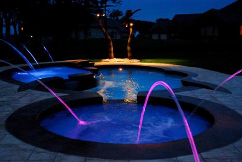 colorful swimming pool lighting in water features