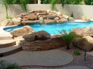 Rock Waterfall in a Free Form Swimming Pool Design