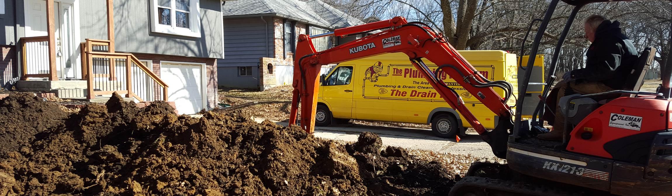 Underground sewer repair job by The Plumbing Pro van