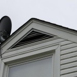 Raccoons enter and bend the louvres of gable vents