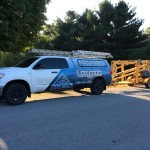 The Trifecta Wildlife Services truck towing an aerial lift