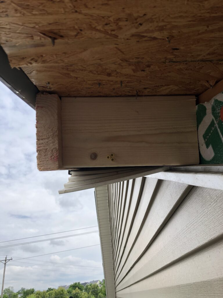 Bracing installed, secured, and the warped fascia drawn in tight