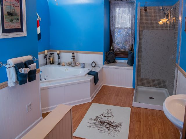 Captains Quarters bathroom showing the shower and Jacuzzi Whirlpool Tub