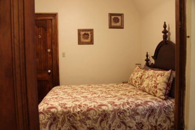 JC's room Queen size bed looking in from the bathroom door