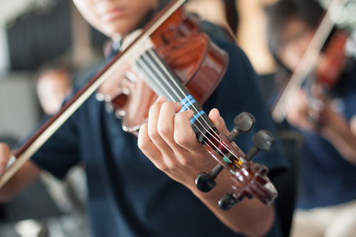 Orchestra student practicing violin