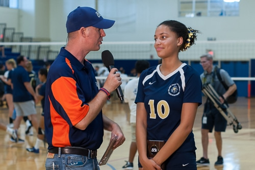 Student volleyball player being interviewed on TV
