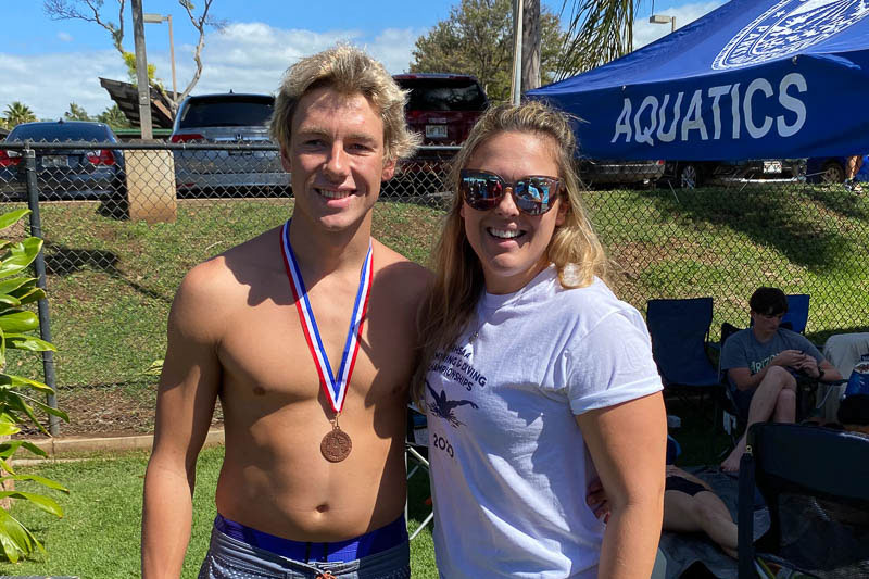 Swimmer with his coach