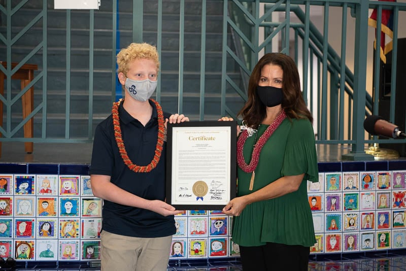 Student receives proclamation from Councilmember Kym Pine