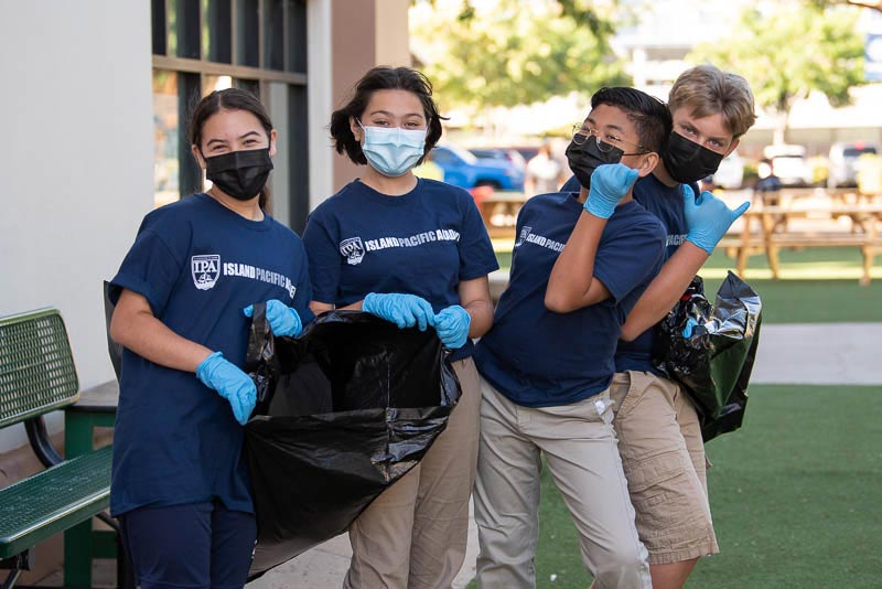Students cleaning campus