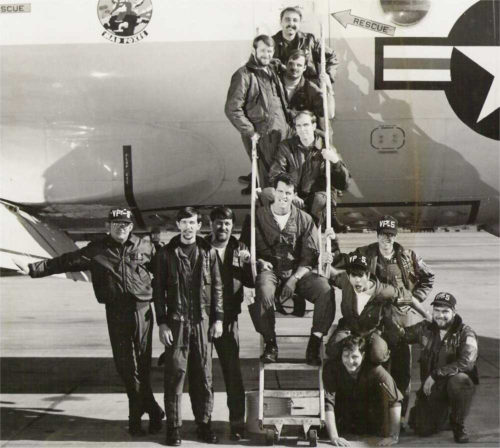 Photo of Navy Captain Bill Diman, W2WLD, (top) and his crew with their P-3 Orion aircraft.