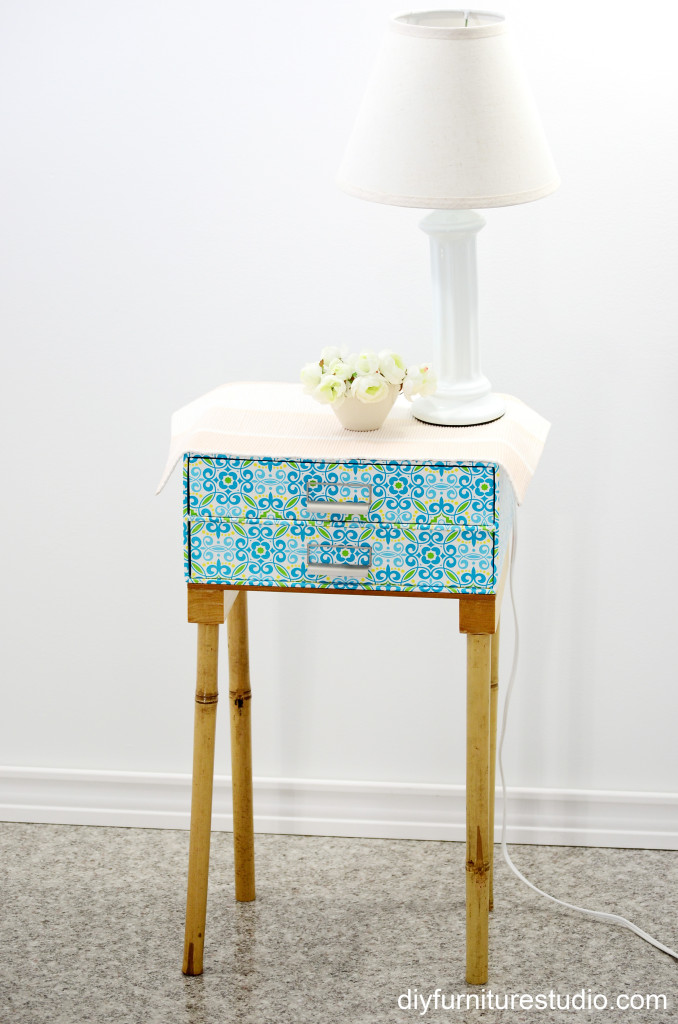 Another view of DIY nightstand made of fiberboard drawer unit and bamboo legs.
