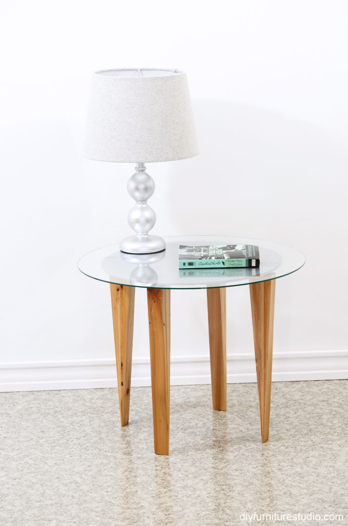 Retro style round side table with wood shim tapered legs.