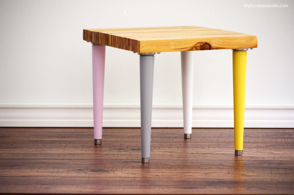 wood shim side table with multicolor mid century legs