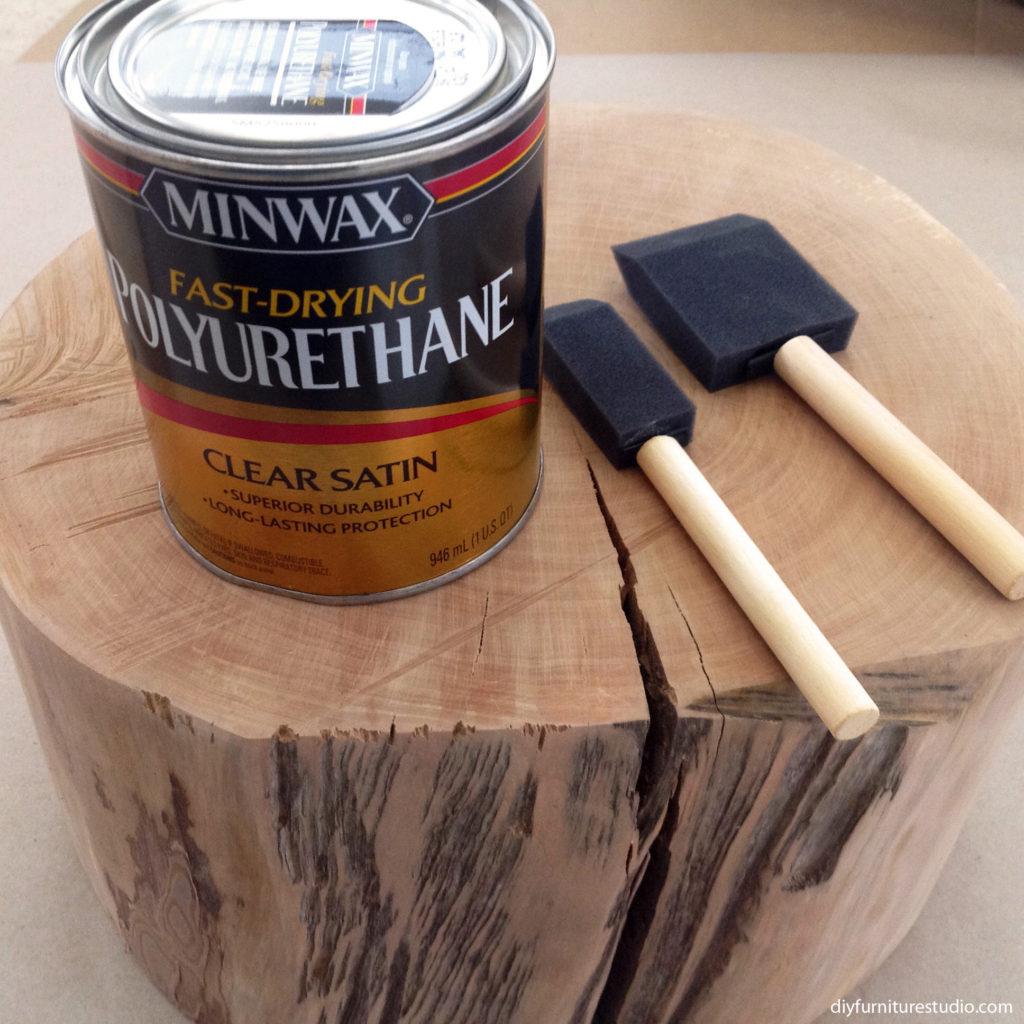 Sealing live edge side table with Minwax polyurethane.