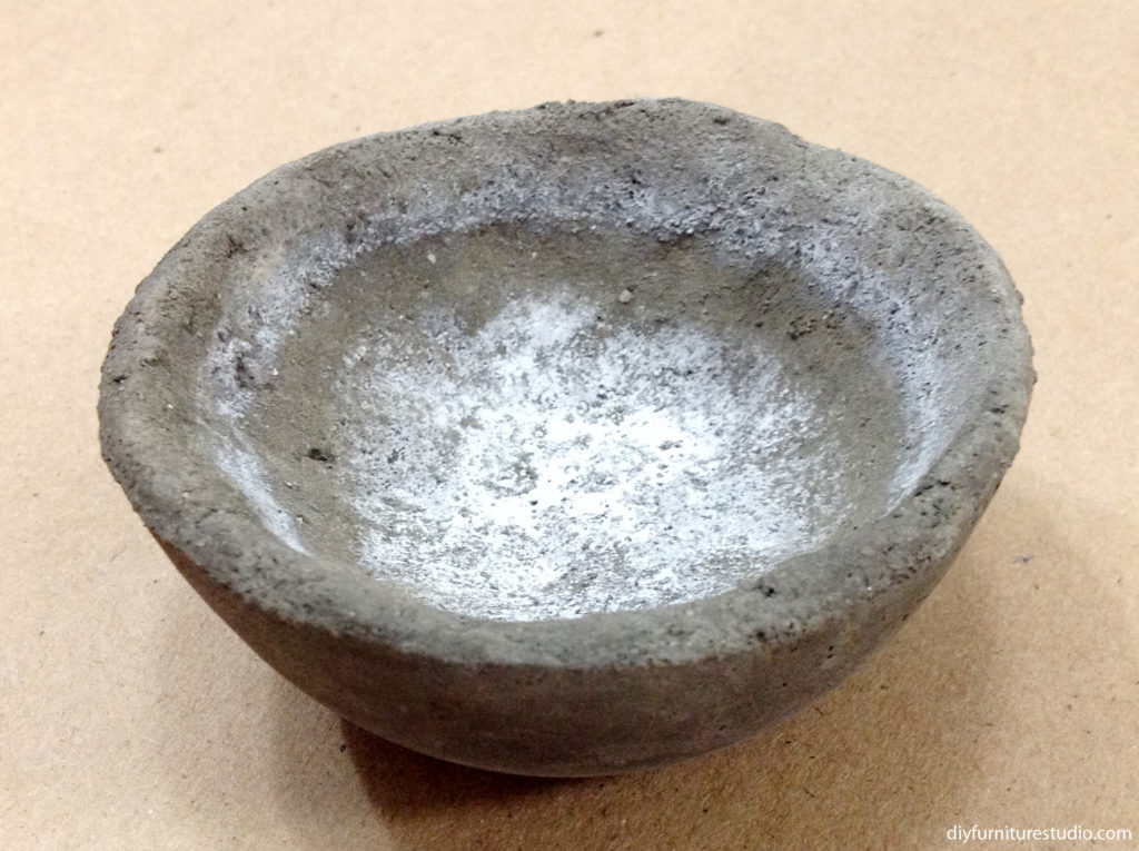 Efflorescence on DIY cement bowl decor.