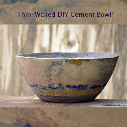 DIY cement bowl tinted with latex paint. Thin-walled so it isn't that heavy. Tutorial.