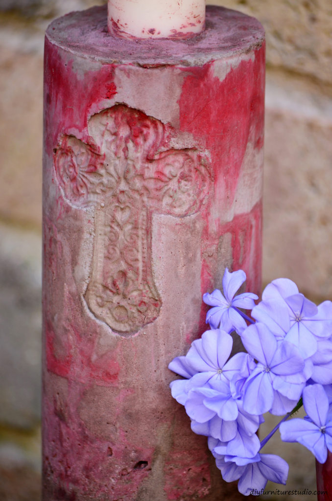 Embedded cross in DIY cement candle holder.