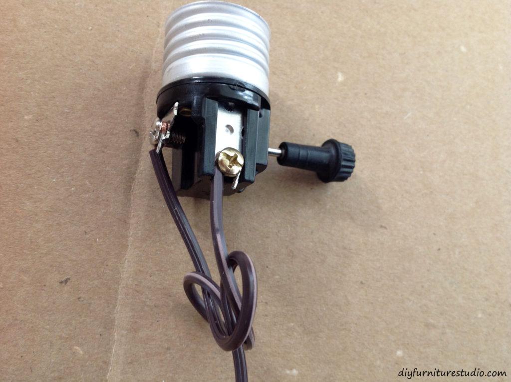 Wiring a DIY natural wood table lamp.