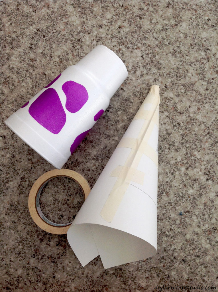 Making a cone-shaped mold using poster board. Cement Christmas tree tutorial.