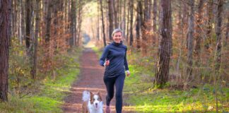 Running a woman and a dog