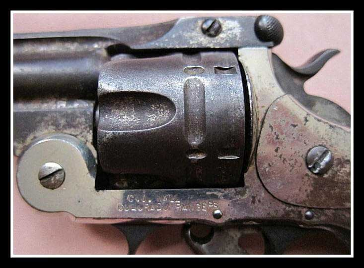 """C. J. Wall, Colorado Rangers"""" is stamped on the left side of the gun frame"""