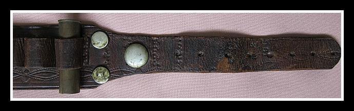 Shotgun Cartridge Belt with old copper rivets at top of belt