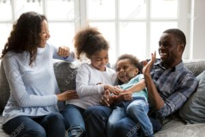 Happy family laughing with children at home warm and comfortable oil heat. Cox Fuel Lowell MA