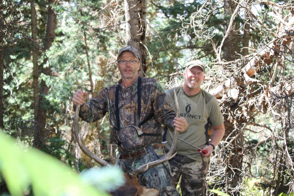 Two hunters with an elk