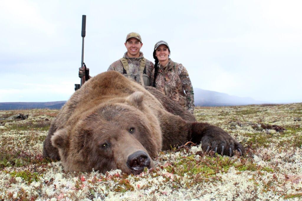 Hunters with an alaskan bear bear