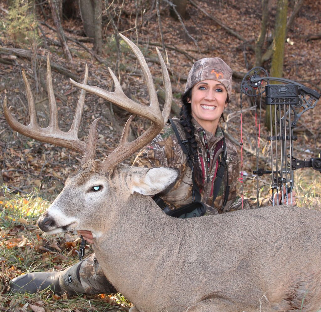 Trophy whitetail deer and woman hunter