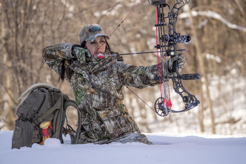 Woman hunter shooting a bow