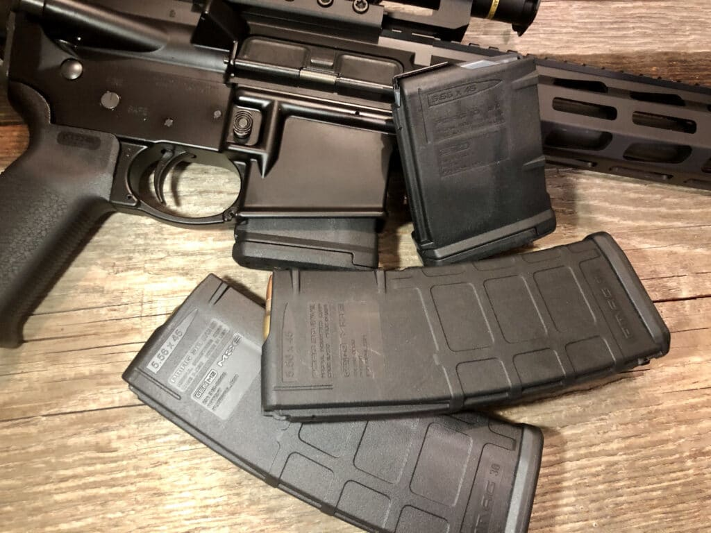 an ar-15 and magazines