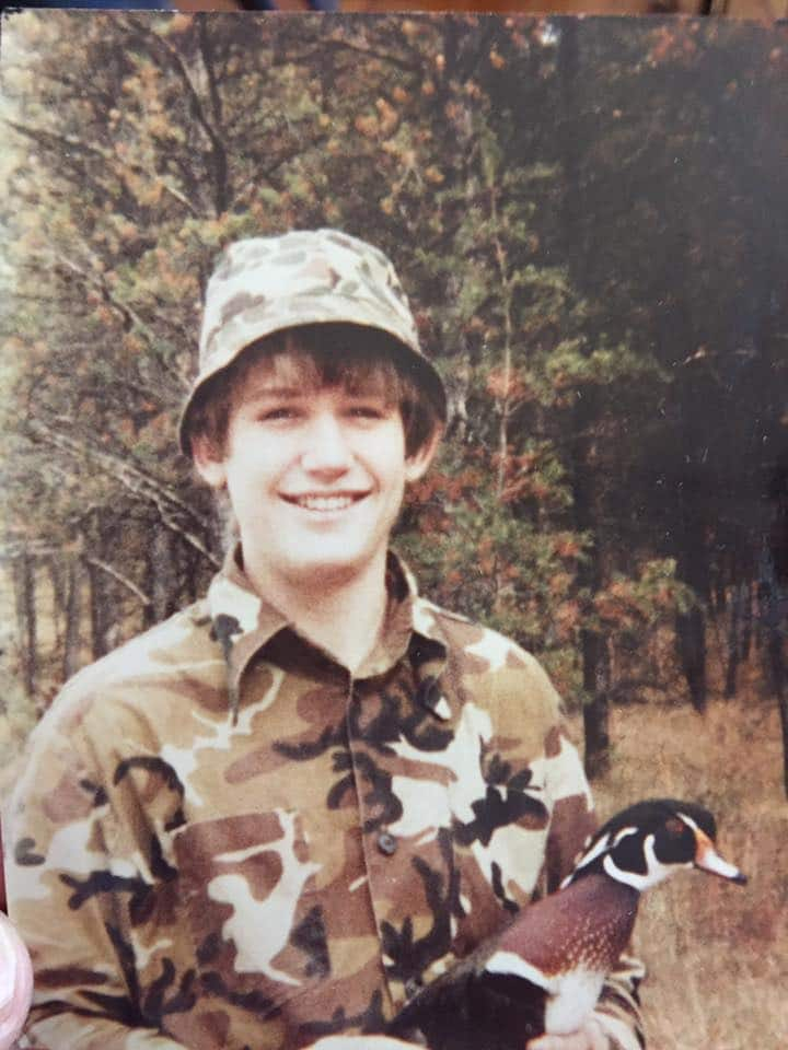 Young Matt Kucharski with wood duck