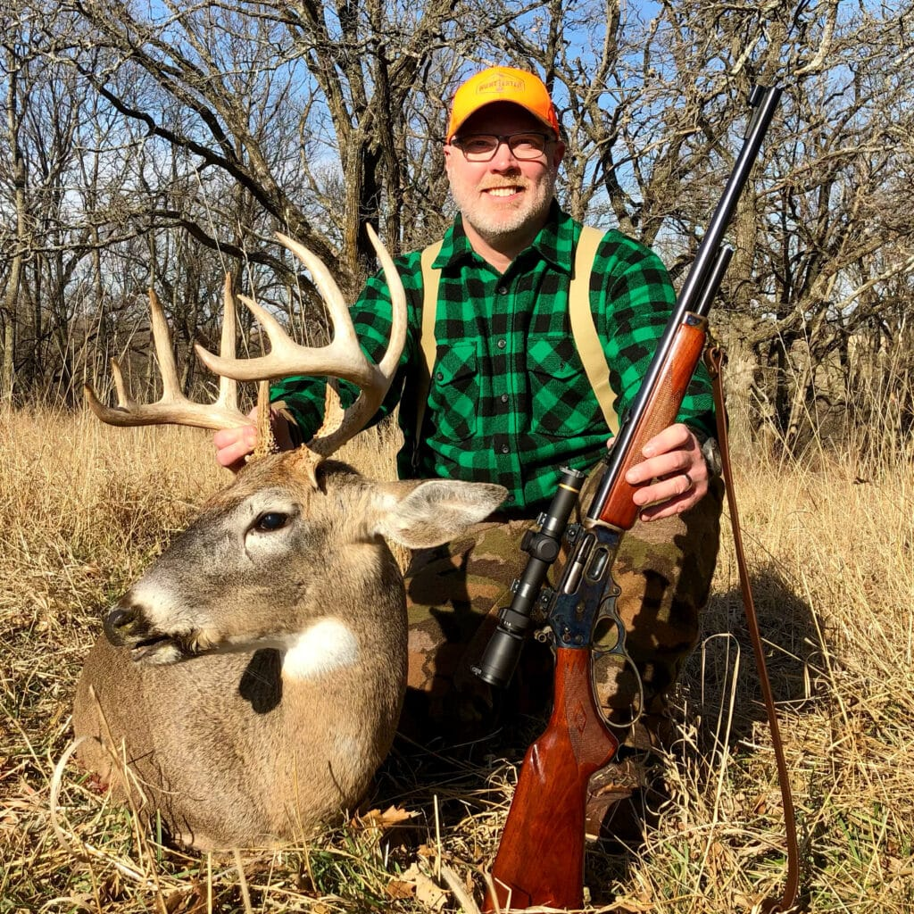 hunter with whitetail buck