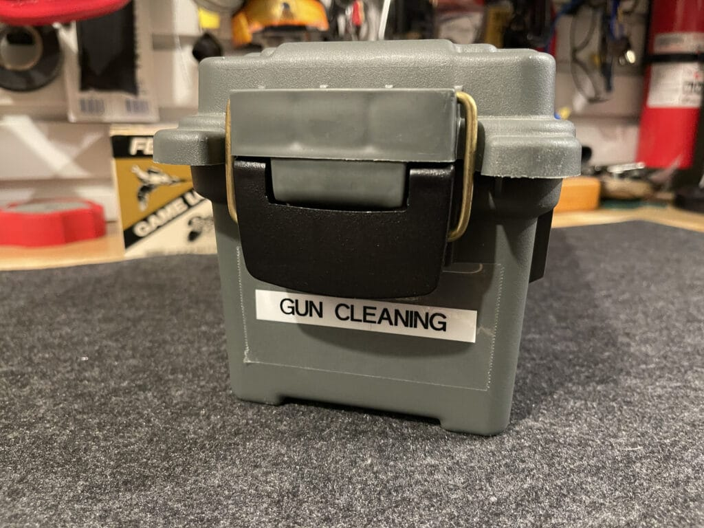 Plastic case with gun cleaning supplies