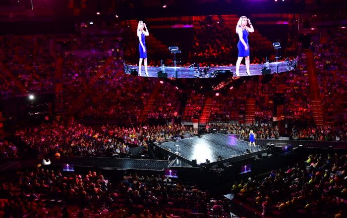 Yvette Speaking To Large Crowd
