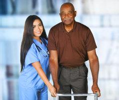 elderly man with a female nurse