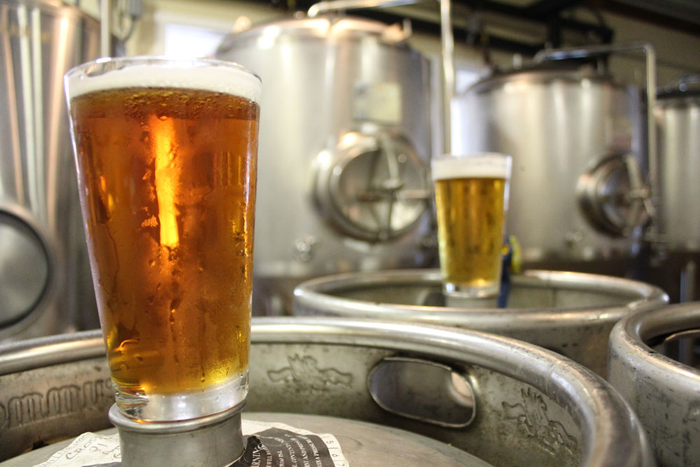 Beers Sitting on Kegs